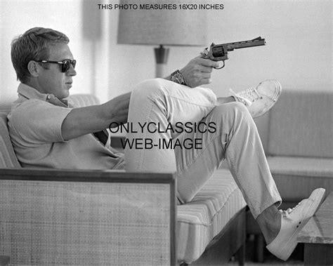 steve mcqueen sofa and gun poster cool steve mcqueen aims gun relaxes on couch photo tennis