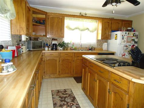 what should i use to clean my kitchen cabinets should i paint my custom solid wood kitchen cabinets