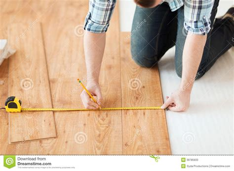 how to measure for flooring close up of male hands measuring wood flooring stock photo image 39785933