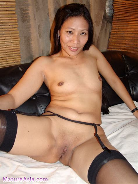 Janna Tall Sexy Asian Milf Wearing Stockings Gives A Sweet