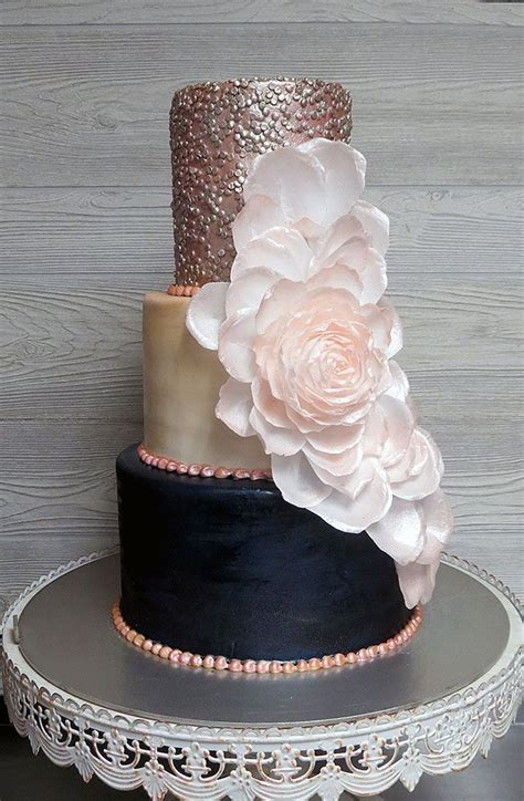 Blush navy and rose gold wedding cake decorated with