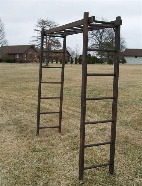 rustic wooden ladder arbor