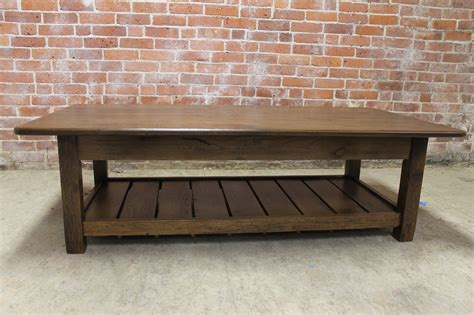 Check out our reclaimed wood coffee table selection for the very best in unique or custom, handmade pieces from our coffee & end tables shops. Rustic Coffee Table with Slatted Shelf Design - ECustomFinishes