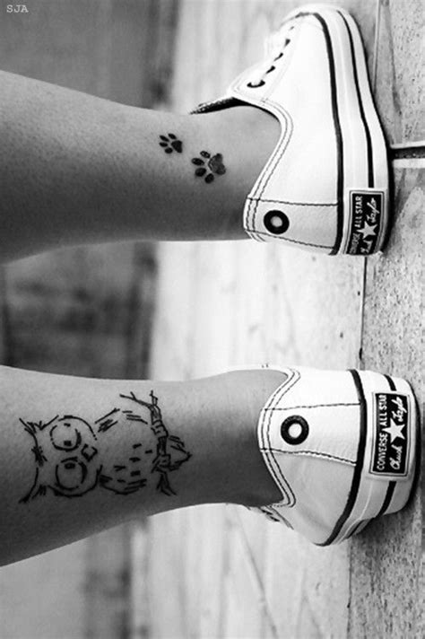 Black pawprints girl tattoo on leg - | TattooMagz › Tattoo Designs / Ink Works / Body Arts Gallery