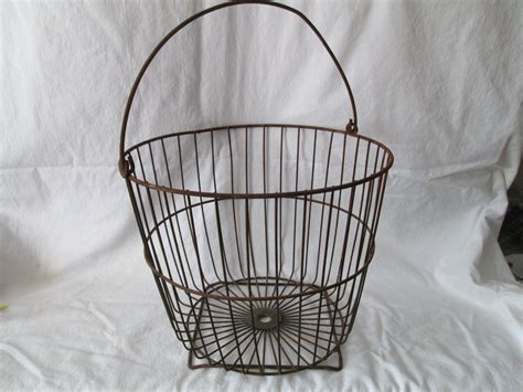 large metal potato gathering basket from