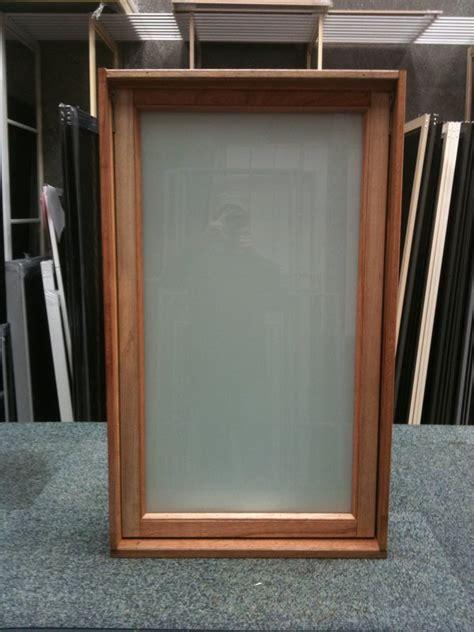 timber awning window    white translucent stock windows  doors