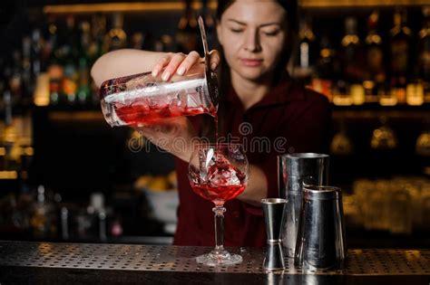 Bartender Girl Making Fresh Light Red Cocktail Stock