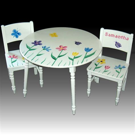 white wooden table with floral and butterfly paint