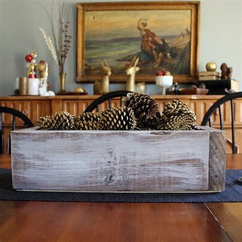 rustic wooden box centerpiece  gold pinecones