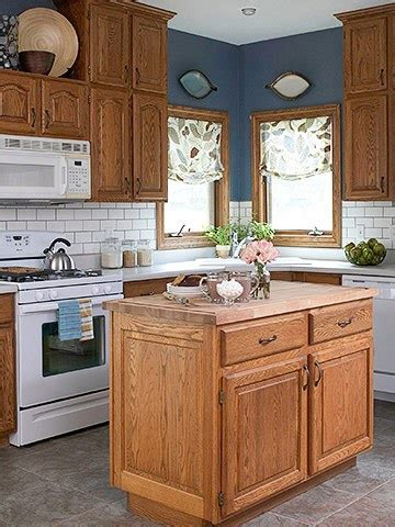 blue kitchen with oak cabinets 7 ideas for updating wood cabinets without painting them 7942