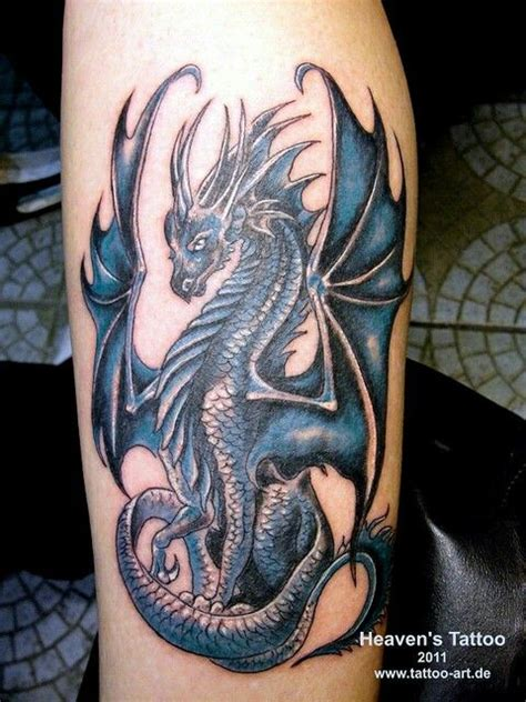 blue ink dragon tattoo  arm