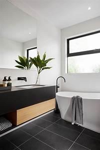 Modern black and white bathroom with black tile & matte ...