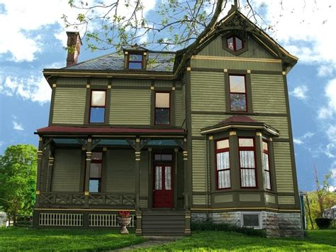 green house with brown trim dark green exterior paint
