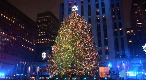 rockefeller center tree lights up new york