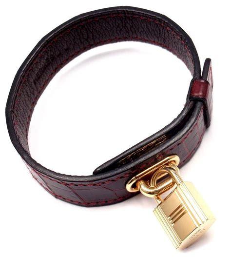 Hermes Crocodile Burgundy Yellow Gold Lock Bangle Bracelet. Do Amore Engagement Rings. Engraved Anklet. Locket Diamond. 18kt Gold Bangle Bracelet. Strong Bracelet. Bangle Bracelets With Hanging Charms. Fake Engagement Rings. Hoop Earrings