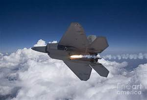 An F-22 Raptor Releases A Flare Photograph by HIGH-G