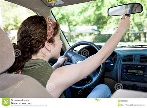 teen driver adjusting rearview mirror stock image image