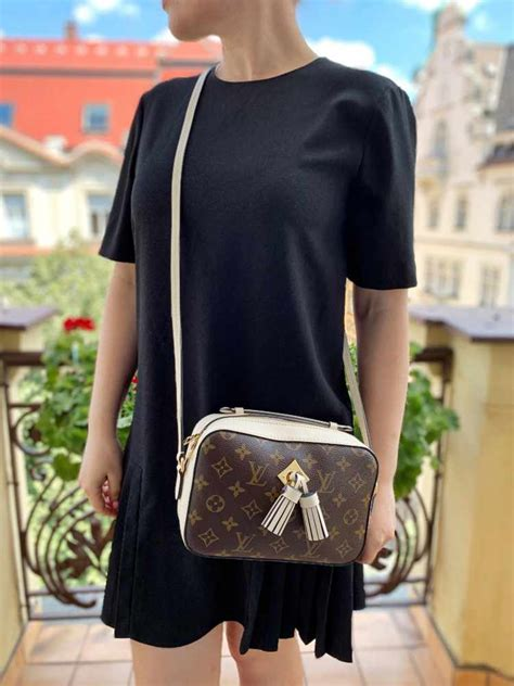 louis vuitton saintonge monogram canvas camera bag creme luxury bags