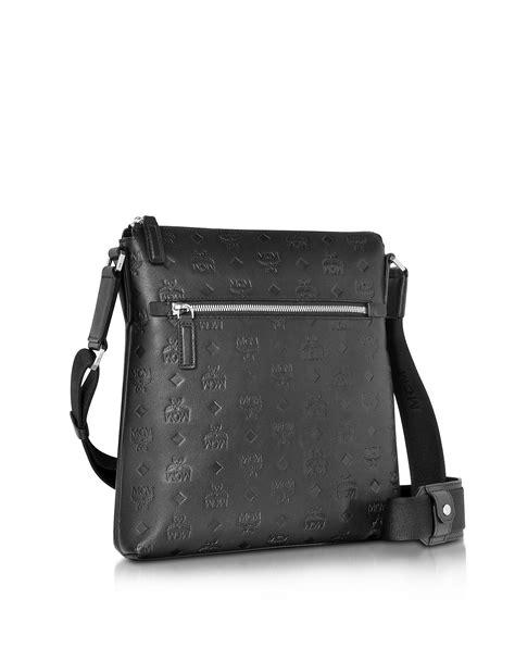 lyst mcm ottomar black monogram leather small messenger bag  black  men