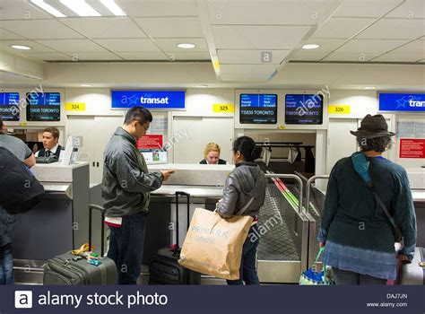 transat airlines check in baggage check in at the transat desk gatwick airport stock photo royalty free image 58178813