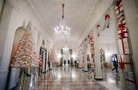 white house decorated  gingerbread houses giant