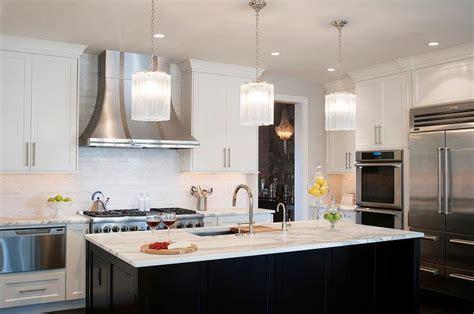 black kitchen island  white glass pendants