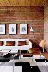 59 cool living rooms with brick walls digsdigs for Brick wall living room design