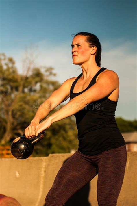kettlebell outside woman using weight snow training