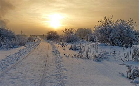 hd sunset   snow covered tracks