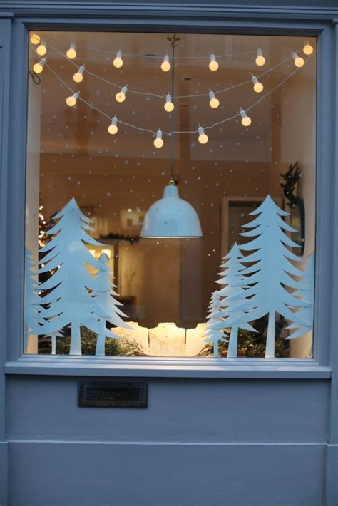 hanging christmas lights on windows outside 70 awesome christmas window décor ideas digsdigs