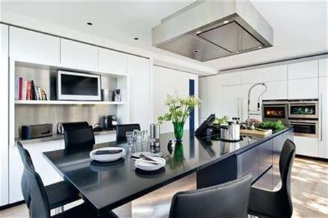 une cuisine ilot belle  lumineuse cote maison