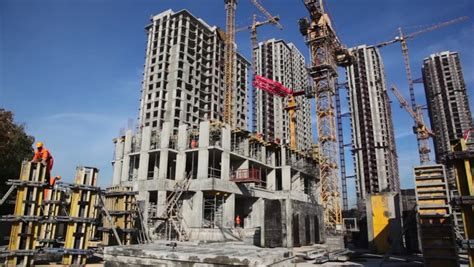 Few Tall Buildings Under Construction And Cranes, Camera