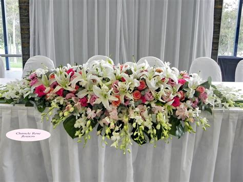 wedding flower arrangements  long table   vow