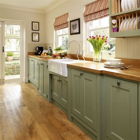 step   traditional muted green kitchen