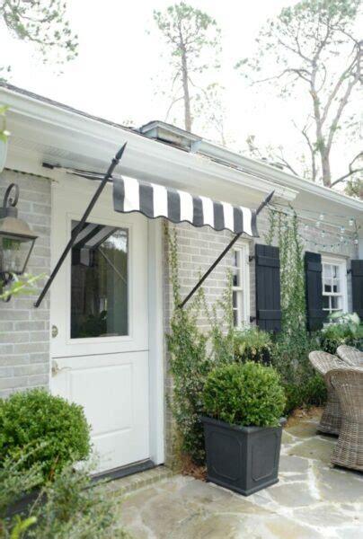 spear door awnings   real wrought iron  sunbrella fabric