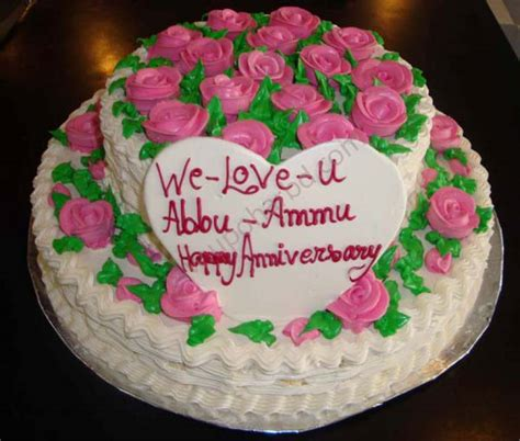 Anniversary And Birthday Cake With Pink Flowers In