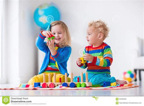 with wooden stock photo image of 592 | kids playing wooden toy train children toddler kid baby play blocks trains cars educational toys preschool 63465630