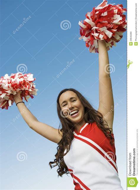cheerleader holding pom poms stock photo image