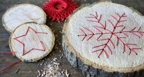 baumscheiben mit fadengrafik basteln mit baumscheiben weihnachten basteln weihnachten und