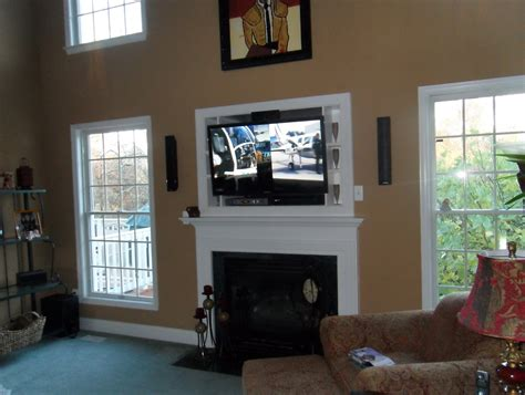 tv above fireplace where to put components where to put tv above fireplace cable box decorating