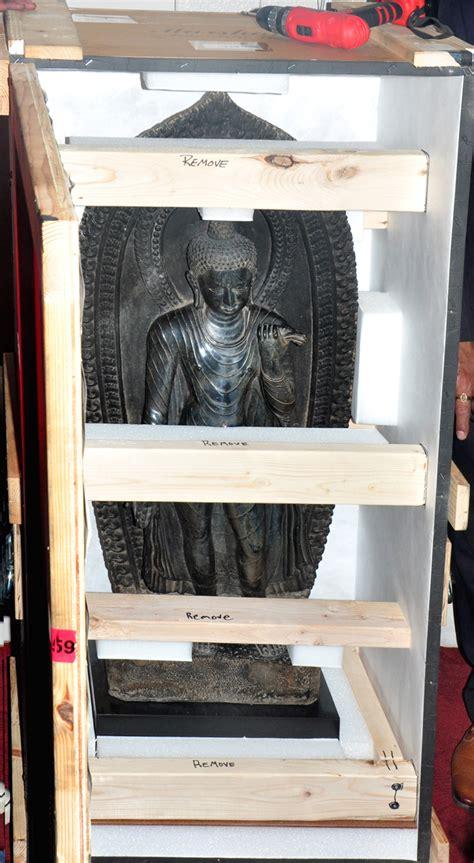 century standing buddha    century uma