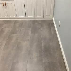 trafficmaster ceramica 12 in x 24 in coastal grey vinyl tile flooring 29 sq ft