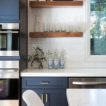Navy Blue Kitchen Cabinets with Brushed BRass Pulls and