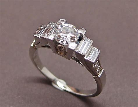 bague d 201 co avec diamant central de 0 65 ct et diamants baguette