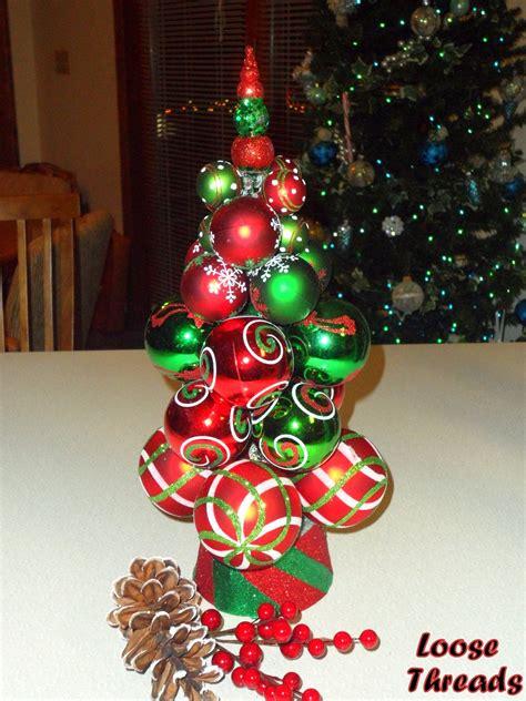 loose threads knitting needle christmas tree