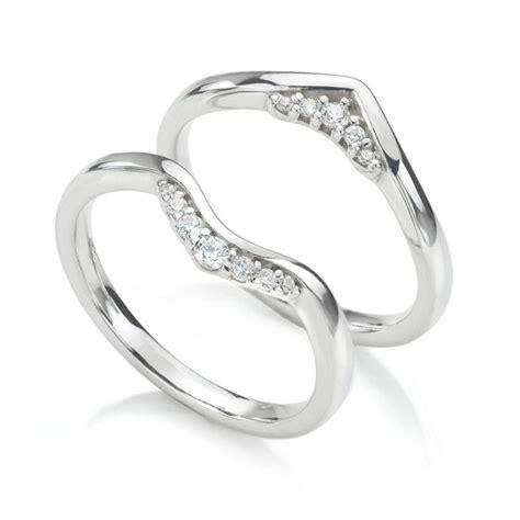both tiara and coronet wedding rings shown
