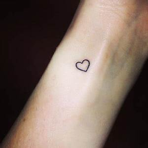 Tiny Heart Tattoo On Left Forearm