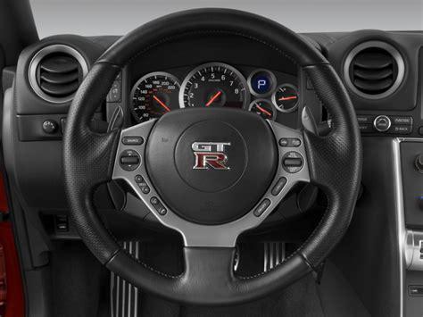 image  nissan gt   door coupe steering wheel size