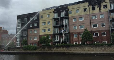 Wharfside flats fire in Wigan: Residents told they may ...