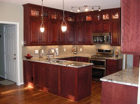 Decorating Ideas For Kitchen With Cherry Cabinets by Cherry Kitchen Cabinets With Gray Wall And Quartz